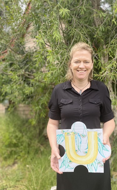 Sarah Southam with her beautifully painted puzzle piece. Sarah has enjoyed her time with the Murrindindi Shire Council during COVID-19 and the blue gums with their stunning eucalypt perfume.